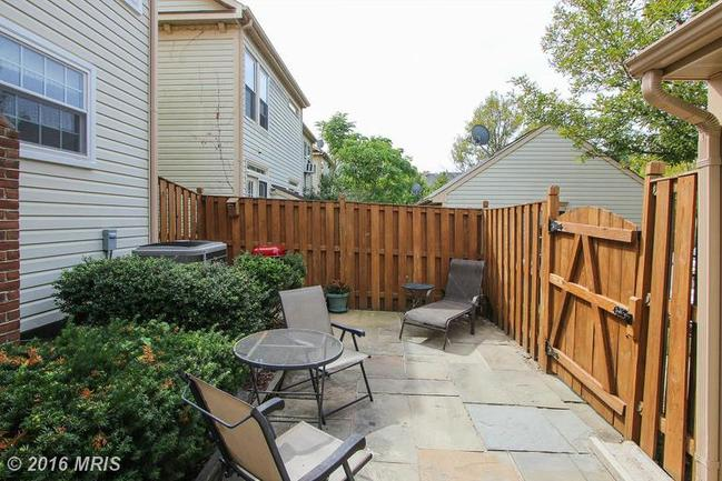 flagstone fenced patio