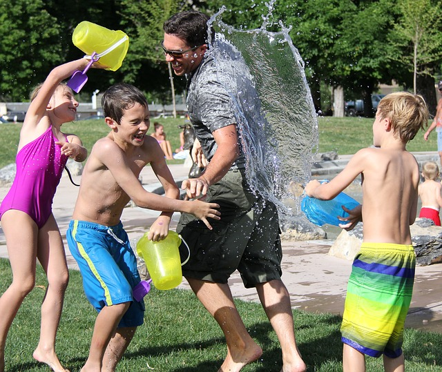 kids playing with water in a park