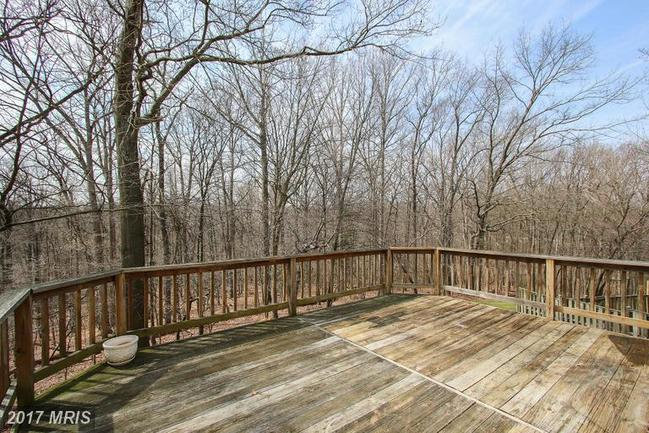 large deck with wooded views