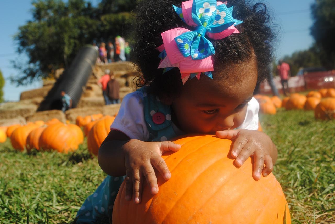 girl on pumpkin patch