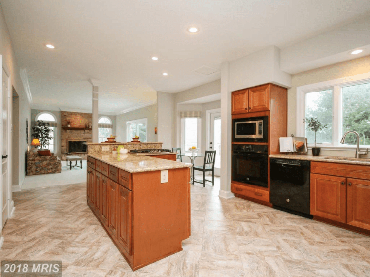 Large kitchen with wood cabinets and large appliances.