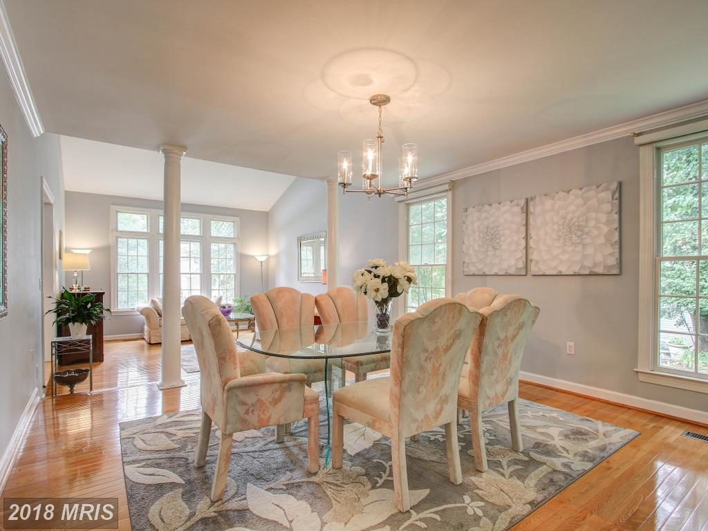 Dining room with hanging light fixture.