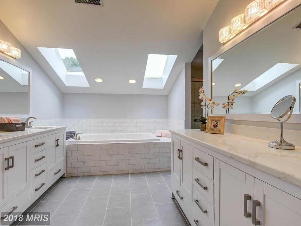 Spacious master bathroom with large soaking tub.