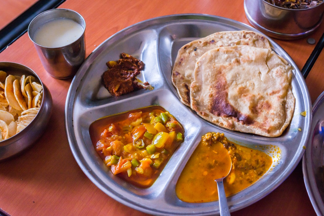A plate of various Indian dishes.