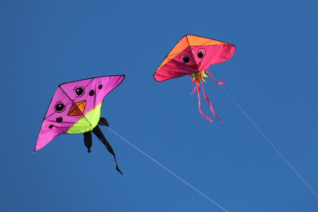 two kites in the sky.