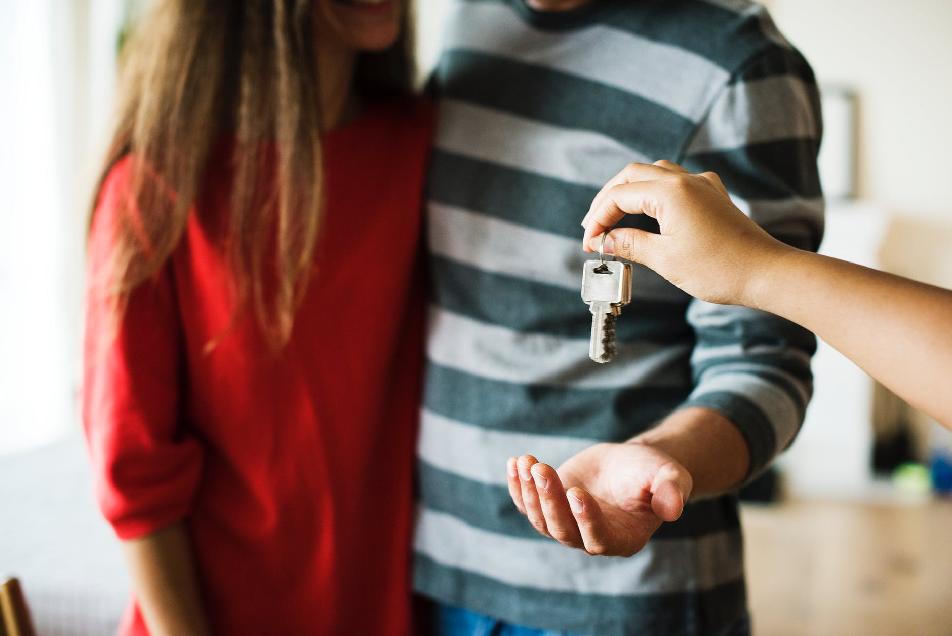 People being handed keys to a home.