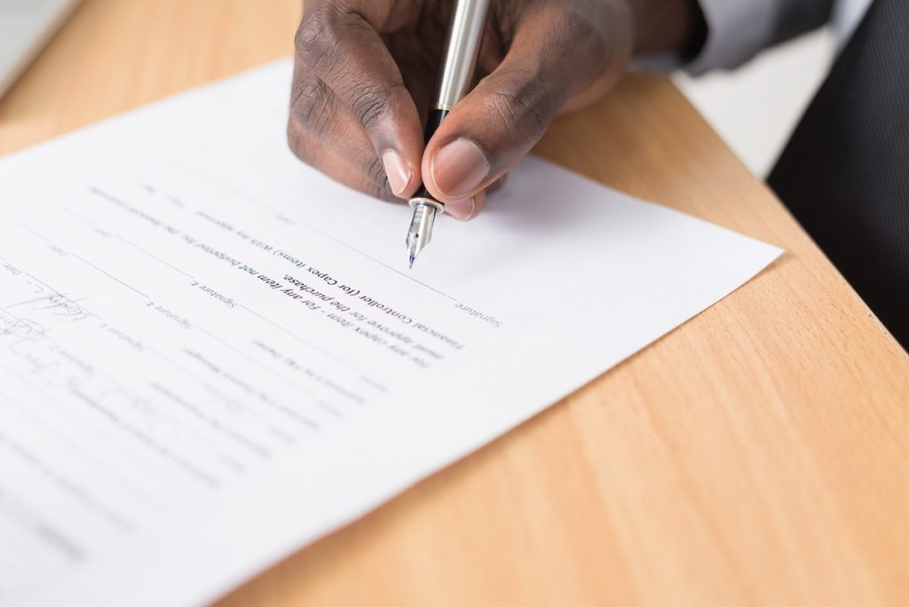 Signing paperwork for mortgage rates